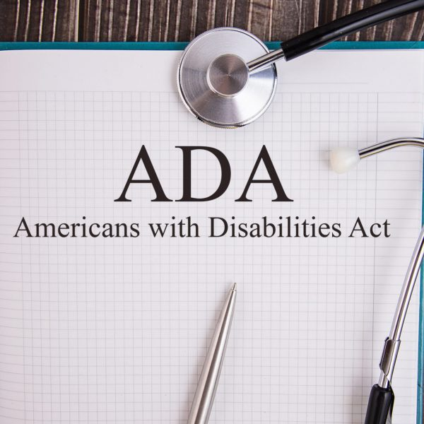 ADA Accessibility | Notebook and Stethoscope | AcuPerfect Websites